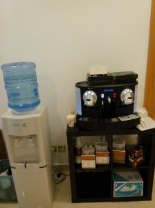 Yes, een koffiemachine ipv een huistuin en keuken nespresso ding en men watercooler